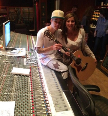 Justin Bieber with a fan in the studio